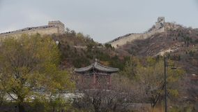 Visitor climbing Great Wall on mountain peak,China ancient architecture,fortress. stock video footage