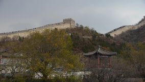 Visitor climbing Great Wall on mountain peak,China ancient architecture,fortress. stock video