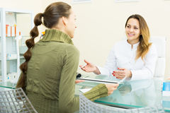 Visitor consulting woman beautician in aesthetic center Royalty Free Stock Image