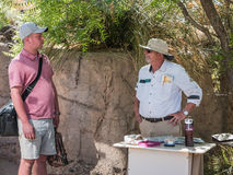 Visitor consults Arizona-Sonora Desert Museum docent Royalty Free Stock Photos