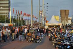 The visitor crowd at the Sail Amsterdam 2015. Piet Heinkade, Amsterdam, the Netherlands - August 21, 2015: View of the cowded main walking path for the Stock Image