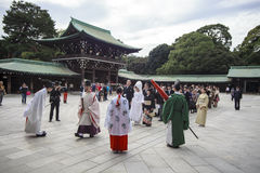 Visitor dresses up a traditional dree at Meiji-jingu shrine Royalty Free Stock Photo