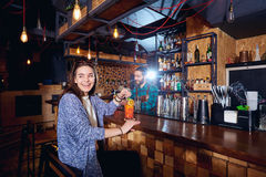 A visitor girl smiles in  bar with  cocktail Royalty Free Stock Photography