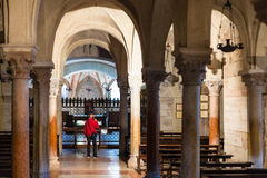 Visitor inside of Basilica di San Zeno in Verona. VERONA, ITALY - MARCH 27, 2017: visitor inside of Basilica di San Zeno San Zeno Maggiore, San Zenone in Verona Royalty Free Stock Image
