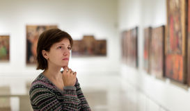 Visitor looking pictures in  gallery Royalty Free Stock Photos