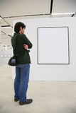 Visitor Looks On Frame In Showroom Stock Photos