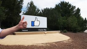 Liking facebook headquaters in menlo park. A visitor makes a liking facebook sign at the facebook headquaters in menlo park, california stock footage