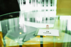 Visitor plastic card on glass table Stock Photo