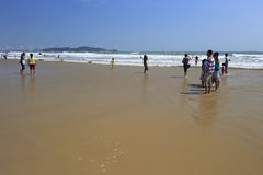 Visitor play on the sandy beach Stock Photography