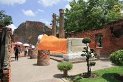 Visitor praying the sleeping buddha in the ancient temple, in Ayutthaya, Thailand Royalty Free Stock Photography