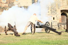 Visitor shooting from cannon Stock Images