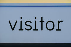 Visitor sign painted blue Royalty Free Stock Photo