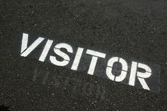 Visitor sign on pavement Stock Photo