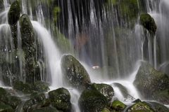 Visitor stands behind the Grand Waterfall in park Sonsbeek i Stock Photography