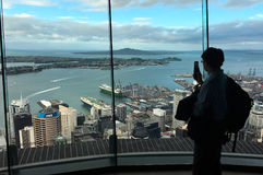 Visitor take photo with his mobile phone from Aucklands Sky Tow royalty free stock photo