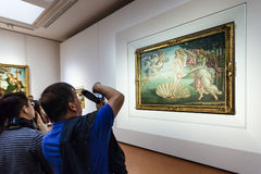 Visitor take photo in room of Uffizi Gallery Stock Images