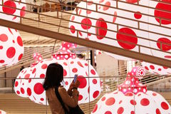 A visitor takes a photo of pumpkin lanterns by Yayoi Kusama at the Ginzasix shopping complex in Tokyo. Royalty Free Stock Photo