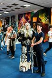 Visitor taking photos with a Lich King cosplayer Royalty Free Stock Photos