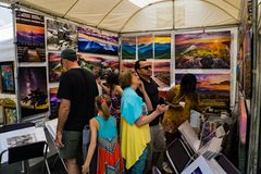 Visitor to a Booth at the 61th Annual Sidewalk Art Show royalty free stock photography