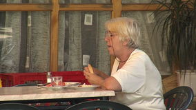 A visitor to the cafe in Petrich, Bulgaria stock footage