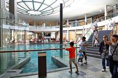 Singapore : Rain Oculus within Marina Bay Sands. Visitor to Marina Bay Sands under the Rain Oculus royalty free stock image