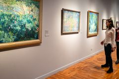Visitor views paintings in New Tretyakov Gallery royalty free stock photos