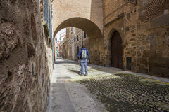 Visitor walking by Encarnacion Street at medieval old town of Pl Royalty Free Stock Photos