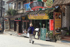 Visitor walking on a street with many restaurants in Sapa Royalty Free Stock Photo
