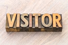 Visitor word in wood type Stock Photo