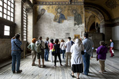 Visitors admire the Deesis mosaic 13th-century in Aya Sofya in Istanbul in Turkey. Stock Photo