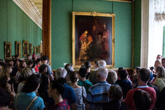 Visitors admire paintings by Rembrandt,. ST. PETERSBURG, RUSSIA - JULY 12, 2016: Visitors admire paintings by Rembrandt, `The Return of the Prodigal Son stock image