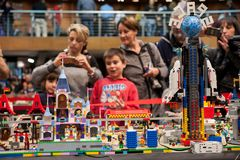 Visitors admired a large construction made of Lego plastic brick. Florence, Italy - November 11, 2017: Visitors at the `Florence Bricks Festival` admired a royalty free stock images