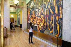 Visitors admiring the famous mural paintings at the museum of Pa Stock Image