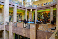 Visitors admiring the murals at the Palacio de Bellas Artes in Mexico City. MEXICO CITY,MEXICO - DECEMBER 28,2016 : Visitors admiring the famous mural paintings Stock Photo