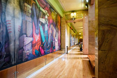 Visitors admiring the murals at the Palacio de Bellas Artes in Mexico City. MEXICO CITY,MEXICO - DECEMBER 28,2016 : Visitors admiring the famous mural paintings Royalty Free Stock Photos