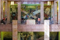 Visitors admiring the murals at the Palacio de Bellas Artes in Mexico City. MEXICO CITY,MEXICO - DECEMBER 28,2016 : Visitors admiring the mural painting by Diego Stock Images