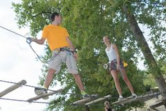 Visitors in adventure park clambering with ropes. Adventure royalty free stock photos