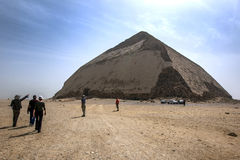 Visitors approach the Bent Pyramid at Dahshur in Egypt. Royalty Free Stock Photography