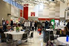 Art fair at local school. Visitors at an art fair in a local school Royalty Free Stock Photos