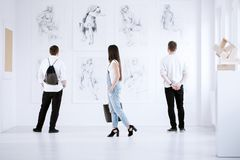 Visitors of art gallery royalty free stock photography