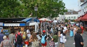 Visitors at an Art Market in Monmatre, Paris France. Stock Photos