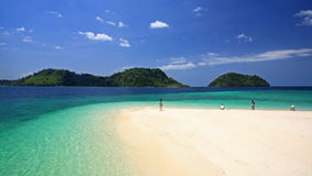 Visitors on beach against crystal andaman sea at Lipe island Stock Photo