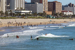 Visitors on beach Agaist City Skyline in Durban Royalty Free Stock Photos