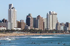 Visitors on beach Agaist City Skyline in Durban Royalty Free Stock Photo