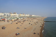 Visitors at the beach in Brighton, UK Royalty Free Stock Images