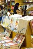 Visitors behind book shelf at The Logos Hope. Royalty Free Stock Image