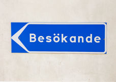Visitors. Blue signpost with text in Swedish  visitors besokande Royalty Free Stock Photography