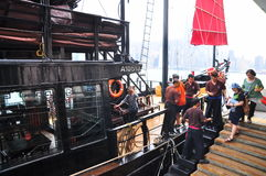 Visitors are boarding on a classic boat to travel on the sea of Hong Kong. Hong Kong, China - September 7, 2015: Visitors are boarding on a classic boat to Royalty Free Stock Photo