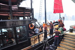 Visitors are boarding on a classic boat to travel on the sea of Hong Kong. Hong Kong, China - September 7, 2015: Visitors are boarding on a classic boat to Royalty Free Stock Photography