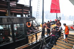 Visitors are boarding on a classic boat to travel on the sea of Hong Kong. Hong Kong, China - September 7, 2015: Visitors are boarding on a classic boat to Stock Images